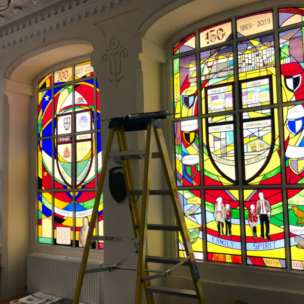 Installation of stained glass in progress