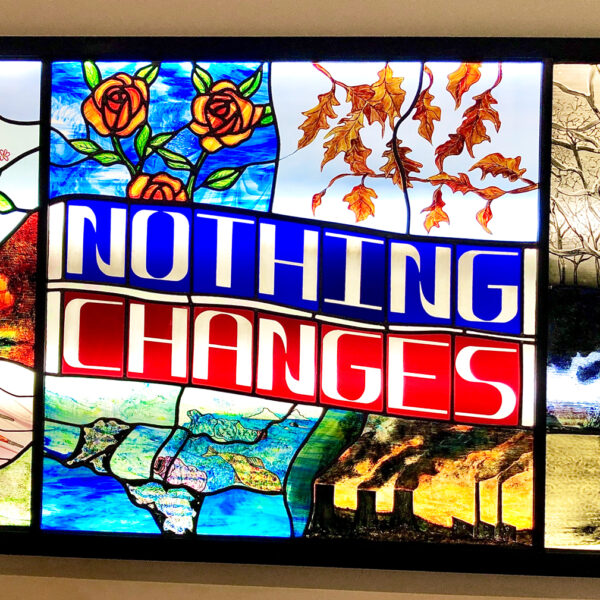 'Nothing Changes' in a backlit panel